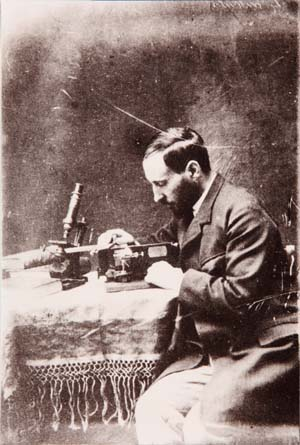 Santiago Ramón y Cajal portrait managing the microtome, 1884-1887