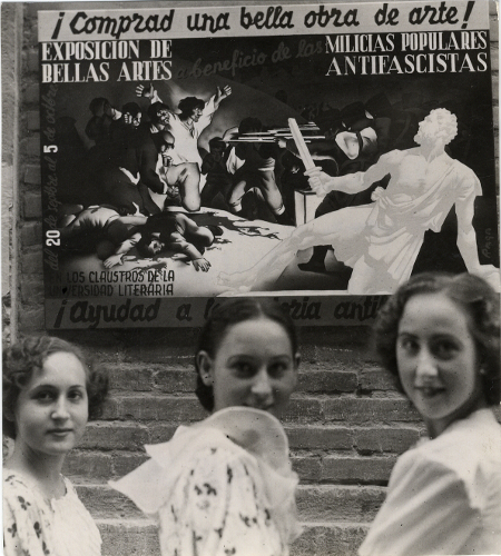 Three young people in front of the Fine Arts poster