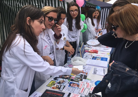 The principal Mª Vicenta Mestre attends the XIII Health Exhibition
