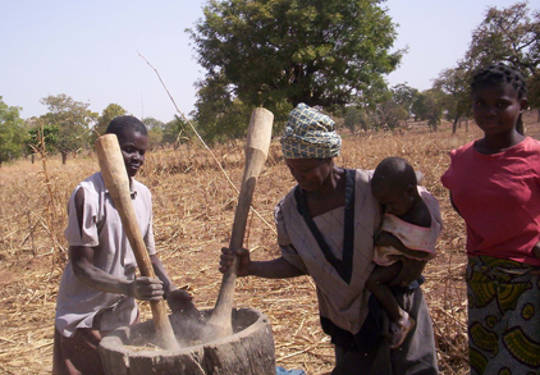 Women working in the processing of fortified flour in Burkina Faso.